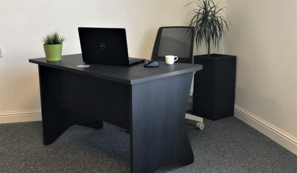 Black wood table in home office
