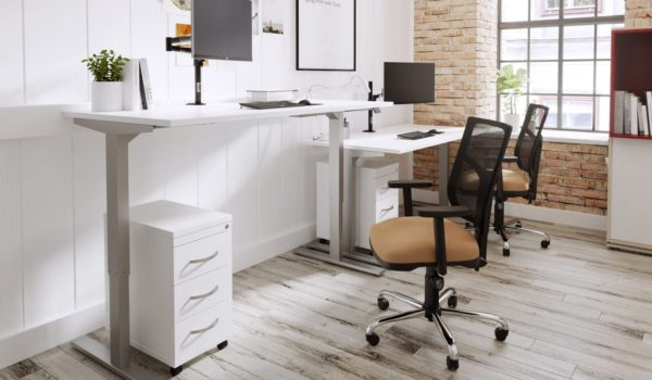 White sit stand desk in office